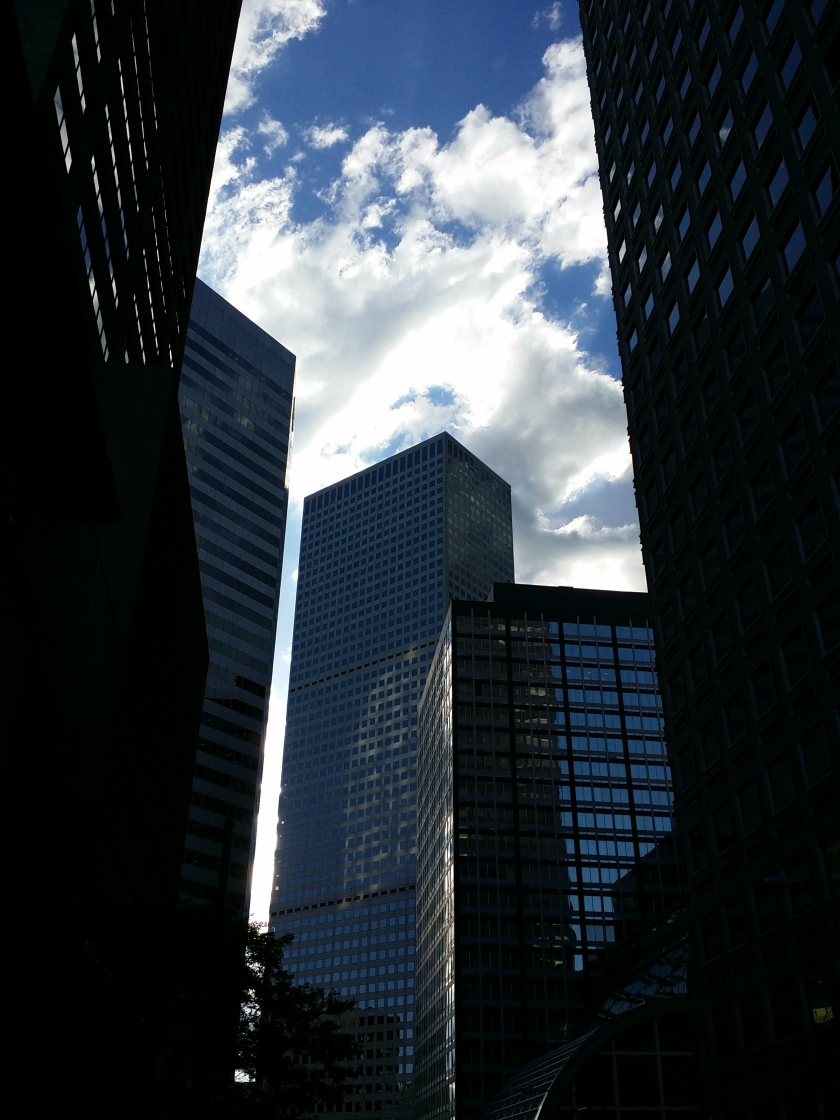Tall buildings in downtown Denver, Colorado loom over you like man made mountains.