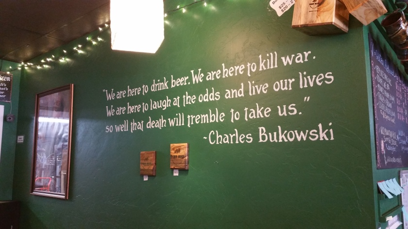 A Charles Bukowski quote on the wall inside the Very Nice Brewery in Nederland, CO.
