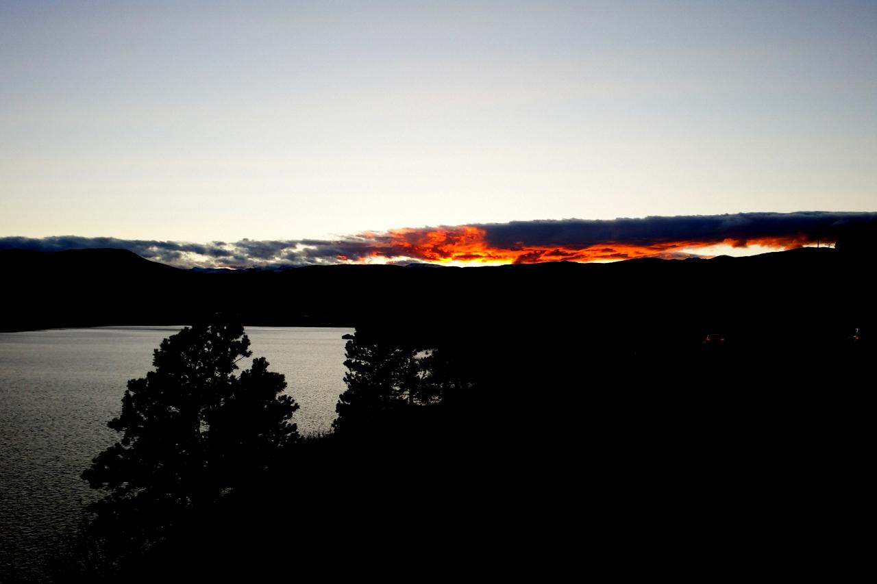 The sunset over Barker Reservoir in Nederland lights the sky aflame