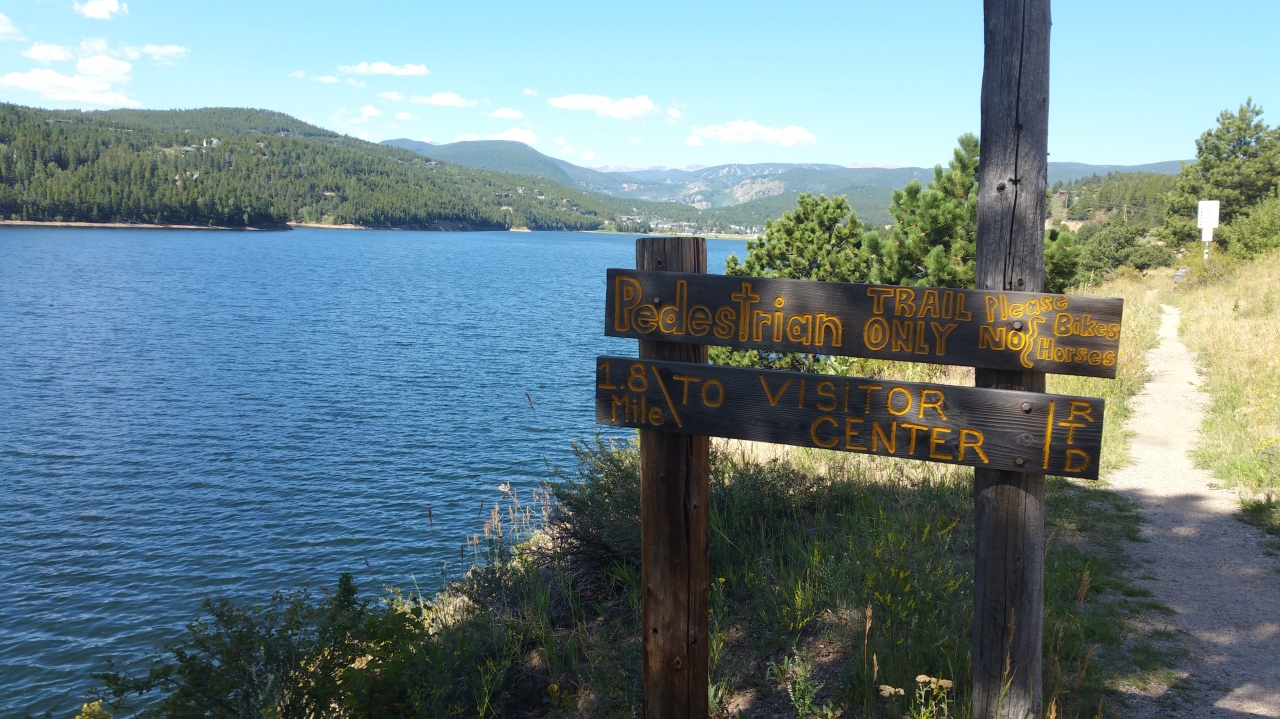 Pedestrian Trail sign and view of Barker Reservoir in Nederland, Colorado