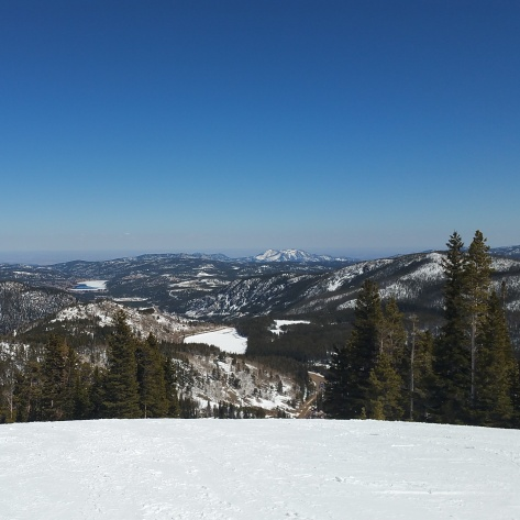 A view of the Rocky Mountains from the top of a ski run at Eldora Mountain Resort in Colorado