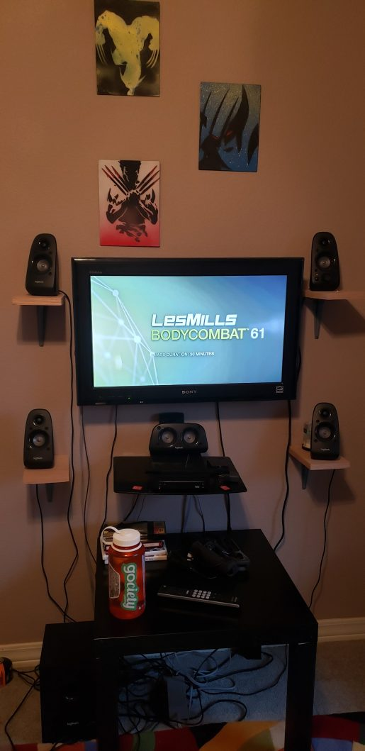 A television showing Les MIlls Bodycombat on the screen