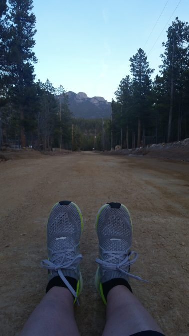 runner sitting on a dirt road